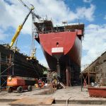Franna being lowered into No 7 dry dock Cammel Lairds for screw shaft replacement on Navy ship