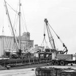 25t Coles crane replacing loading hatch covers at Liverpool docks