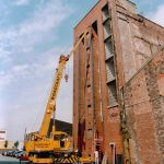 K6 telephone kiosk being lifted into warehouse with 25t Coles crane