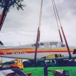 light aircraft being loaded onto transport